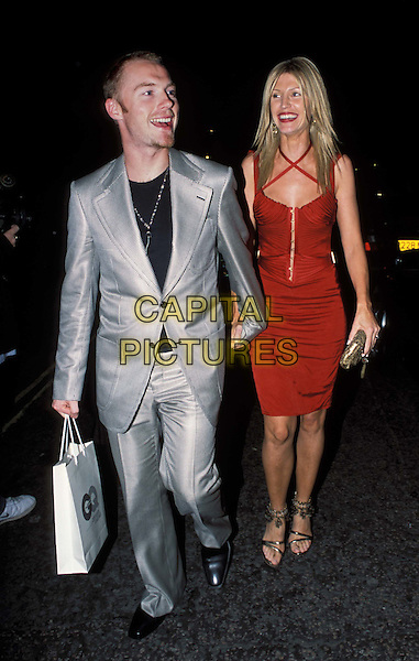 RONAN KEATING, YVONNE KEATING.GQ Men Of The Year Awards at The Royal Opera House.and Aftershow party at the Amphitheatre Bar.www.capitalpictures.com.sales@capitalpictures.com.© Capital Pictures.silver trouser suit, goodie bag, goody bag..full length, full-length