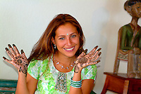 Woman with hands dyed with Mendi (henna) prior to her wedding ceremony