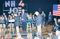 Former Secretary of State John Kerry and Democratic presidential candidate and former Vice President Joe Biden wait to speak at a Biden campaign event at The Sports Barn in Hampton, New Hampshire, on Sun., December 8, 2019.