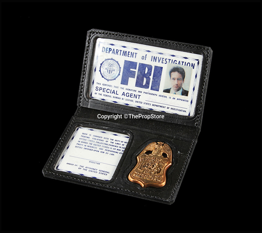 BNPS.co.uk (01202 558833)<br /> Pic: ThePropStore/BNPS<br /> <br /> David Duchovny's Fox Mulder FBI badge from The X-Files.<br /> <br /> Stop! Police! - Hollywoods finest...and funniest id badges come up for auction.<br /> <br /> The world's largest ever collection of IDs belonging to a who's who of film and TV stars is set to be auctioned. <br /> <br /> Credentials used by Hollywood royalty including Jodie Foster, Bruce Willis, Leonardo DiCaprio, Jeremy Irons, Eddie Murphy and Kiefer Sutherland are all about to go under the hammer. <br /> <br /> The lots are being sold on behalf of an anonymous collector who amassed the collection over a period of 15 years. <br /> <br /> They will be auctioned by the Prop Store in London on Tuesday, September 27.