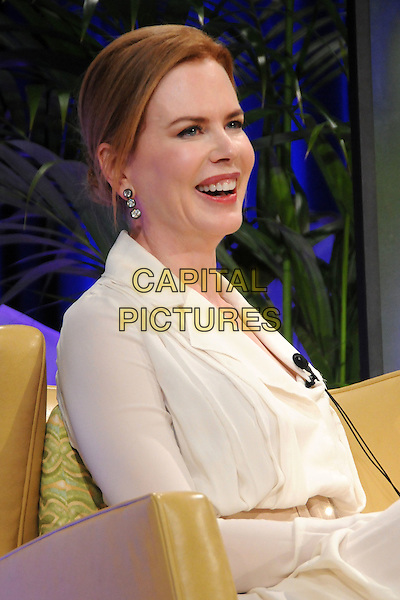 NICOLE KIDMAN .2011 Santa Barbara International Film Festival - Cinema Vanguard Award Presented to Nicole Kidman held at the Arlington Theater,  Santa Barbara, California, USA, .5th February 2011..half length dress white cream shirt sitting down chair smiling .CAP/ADM/BP.©Byron Purvis/AdMedia/Capital Pictures.