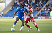 Frank Nouble of Colchester United holds the ball up under pressure from Chris Stokes of Stevenage during Colchester United vs Stevenage, Sky Bet EFL League 2 Football at the JobServe Community Stadium on 5th October 2019