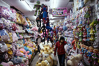 Shoppers browse in a stuffed animal and toy shop in the Fuzi Miao shopping area of Nanjing, Jiangsu, China.
