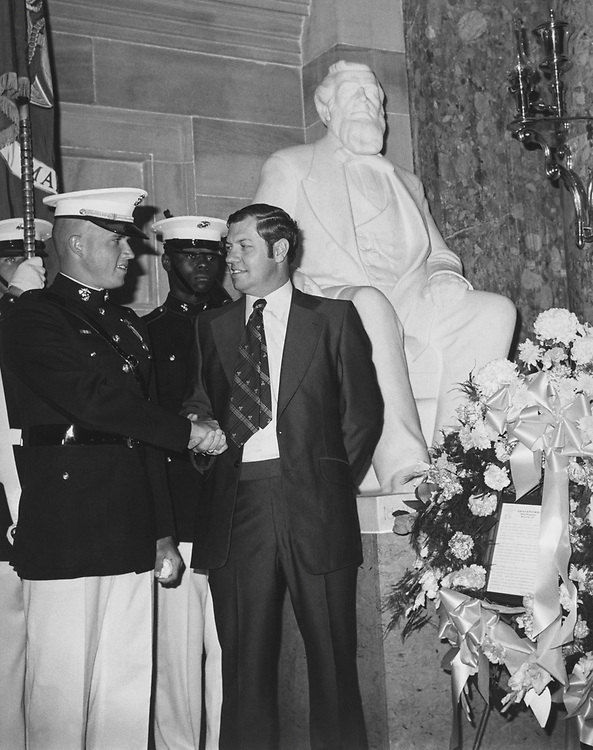 Rep. David Daniel Marriott, R-Utah, and Marine Color Guard at Settler's Day celebration below Brigham Young Statue on Capitol Hill in 1977. (Photo by CQ Roll Call)