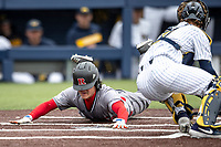 Rutgers Scarlet Knights outfielder Kevin Blum (39) slides safely into home against the Michigan Wolverines on April 27, 2019 in the NCAA baseball game at Ray Fisher Stadium in Ann Arbor, Michigan. Michigan defeated Rutgers 10-1. (Andrew Woolley/Four Seam Images)