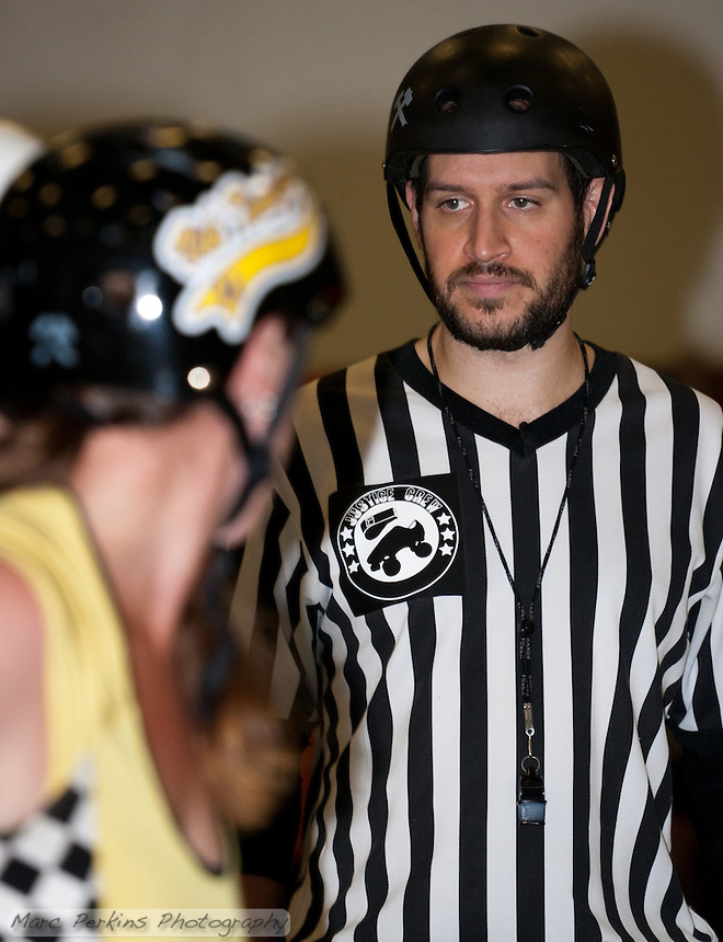 Back Pack Referee Cameltron watches a group of skaters.