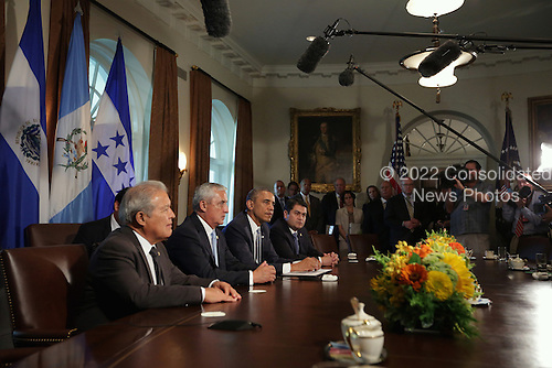 United States President Barack Obama (3rd L) meets with President Otto Perez Molina (2nd L) of Guatemala, President Juan Orlando Hernandez (R) of Honduras, and President Salvador Sanchez Ceren (L) of El Salvador in the Cabinet Room of the White House July 25, 2014 in Washington, DC. The leaders met to discuss the current situation of migrant children traveling alone to the U.S.  <br /> Credit: Alex Wong / Pool via CNP
