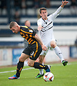 Alloa's Darryl Meggatt and Raith Rovers' Grant Anderson challenge for the ball.