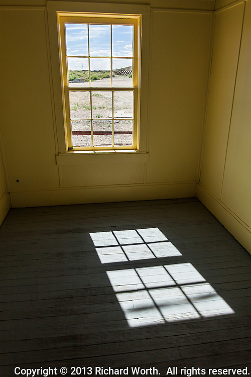 The view from this room in the bridge tender's house at Fort Steele, Wyoming, built in the 1800s,  probably looked then, a lot like it does now - dirt, sage brush, fence and cloud mottled sky.