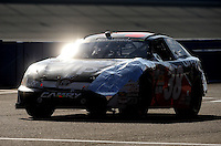 Oct. 10, 2009; Fontana, CA, USA; NASCAR Nationwide Series driver Jason Leffler after crashing during the Copart 300 at Auto Club Speedway. Mandatory Credit: Mark J. Rebilas-