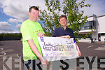 Tommy Sheehy from Knockanish, The Spa, presents Sean Scally from Enable Ireland, with a cheque, the proceeds of his fundraising cycle on Thursday