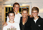 """One Life To Live Kim Zimmer who stars as """"Norma Desmond"""" in Sunset Blvd. poses with her nephers Dan, Sam and Alex (L to R) after the show at the Rehearsal Shed on September 2, 2011. The musical is at the Barn Theatre in Augusta, Michigan. Kim has not seen them in 4 years. (Photo by Sue Coflin/Max Photos)"""