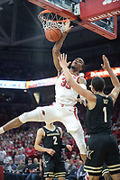 Arkansas guard Jimmy Whitt Jr. (33) dunks the ball Wednesday, Jan. 15, 2020, over Vanderbilt forward Dylan Disu (1) during the first half in Bud Walton Arena. Check out nwaonline.com/photos for a gallery from the game. (NWA Democrat-Gazette/Andy Shupe)
