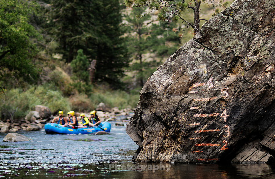 Markings on a rock show the low water level as rafters with Mountain Whitewater Descents pass on the Cache Le Poudre River near Fort Collins, Colorado, Friday, August 24, 2012. The worst drought since the 1950s is ricocheting through the economy, hitting everything from tractor sales in the Midwest to the ability of rafting companies in Colorado to run summer tours on low rivers.<br /> <br /> Photo by MATT NAGER