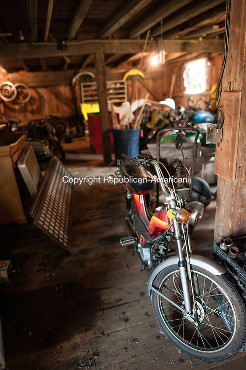 FALLS VILLAGE, CT-12 September 2014-091214EC12-  Ann Bidou's husband  fixes motorcycles on the Toymakers Cafe property in nearby buildings. Erin Covey Republican-American