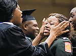 The Gazette Forrestville Military Academy graduate Patrice Marshall, 18 of Forrestville, has her tears of joy wiped away by Testing Coordinator Rosie Pointer of Fort Washington during Forrestville Military Academy's graduation ceremony on Friday Morning at Showplace Arena in Upper Marlboro.
