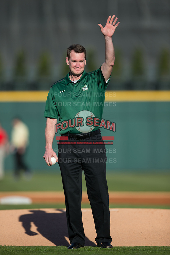 Charlotte 49ers men's basketball head coach Mark Price waves to the fans prior to throwing out a ceremonial first pitch prior to the game against the North Carolina State Wolfpack at BB&T Ballpark on March 31, 2015 in Charlotte, North Carolina.  The Wolfpack defeated the 49ers 10-6.  (Brian Westerholt/Four Seam Images)