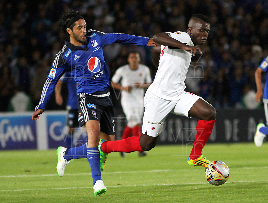 BOGOTA -COLOMBIA, 14-FEBRERO-2015. Fabian Vargas de Millonarios  disputa el balon contra Cristian Canga  del Cucuta Deportivo durante la cuarta  fecha de La Liga Aguila jugado en el estadio Nemesio Camacho El Campin  of  Bogota . /  Fabian Vargas of  Millonarios  dispute for the ball against Cristian Canga  of Cucuta Deportivo  during the fourth round of La Liga Aguila played at the Nemesio Camacho El Campin stadium in Bogota . Photo / VizzorImage / Felipe Caicedo  / Staff