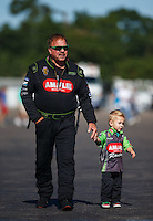 Aug 21, 2016; Brainerd, MN, USA; NHRA top fuel driver Terry McMillen walks with son Cameron McMillen during the Lucas Oil Nationals at Brainerd International Raceway. Mandatory Credit: Mark J. Rebilas-USA TODAY Sports