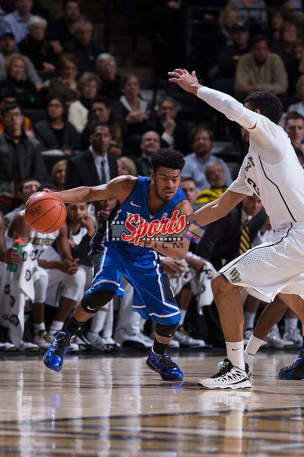 Quinn Cook (2) of the Duke Blue Devils on offense during first half action against the Wake Forest Demon Deacons at the LJVM Coliseum on January 7, 2015 in Winston-Salem, North Carolina.  The Blue Devils defeated the Demon Deacons 73-65.  (Brian Westerholt/Sports On Film)