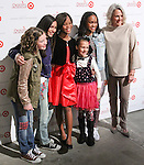 Quevenzhane Wallis (3rd from left, and Renee Ehrlich Kalfus) poses with cast of Annie at the Annie For Target collection celebration and pop-up shop at Stage 37 in New York City on November 4, 2014.