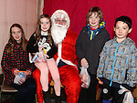 Erin and Lorcan Smith and Asena and Altay Guneyer pictured with Santa when he paid a visit to Slane. Photo:Colin Bell/pressphotos.ie