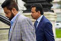 Pictured: Khitish Mohanty (right) arrives at Cardiff Crown Court, Cardiff, Wales, UK. Monday 07 October 2019<br /> Re: An orthopaedic surgeon has appeared in crown court to plead not guilty to two historical sex offence charges.<br /> Khitish Mohanty, 52, from Cardiff, denies allegations that he assaulted a woman on two occasions.<br /> The alleged assaults happened on 17 October 2005.