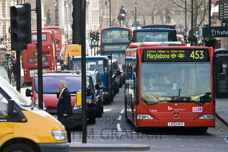 Heavy traffic at a standstill at traffic lights in Trafalgar Square, London city centre, England, United Kingdom
