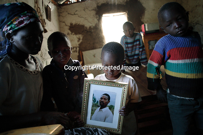 Serah Njoya sits in the living room with her son Jack Githuka, age 3, older brothers John, age 5, Michael, age 7 and Gidrass, age 9, in their house. Photo: Per-Anders Pettersson/Getty Images