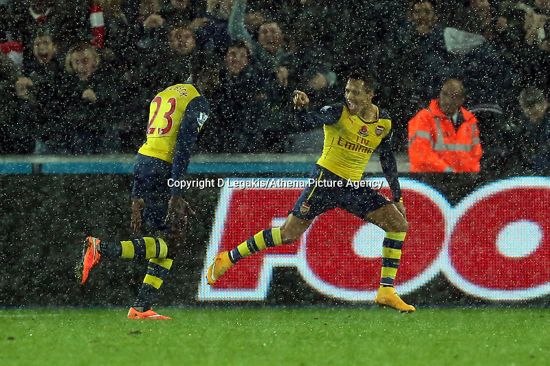 Sunday 09 November 2014 <br /> Alexis Sanchez (R) of Arsenal with team mate Danny Welbeck (L)  celebrating his opening goal<br /> Barclays Premier League, Swansea City FC v Arsenal City at the Liberty Stadium, Swansea, Great Britain. EPA/Dimitris Legakis