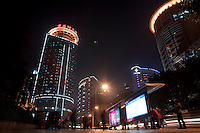 Night View Of People Waiting For A Bus At A Bus Station In Chongqing, China.  © LAN