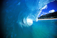 Looking through the tunnel of a wave off Ehukai beach, North Shore