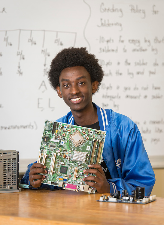 Wheatley High School student Claude Nshongore poses for a photograph in a STEM class at the Barbara Jordan High School for Careers, November 21, 2016.