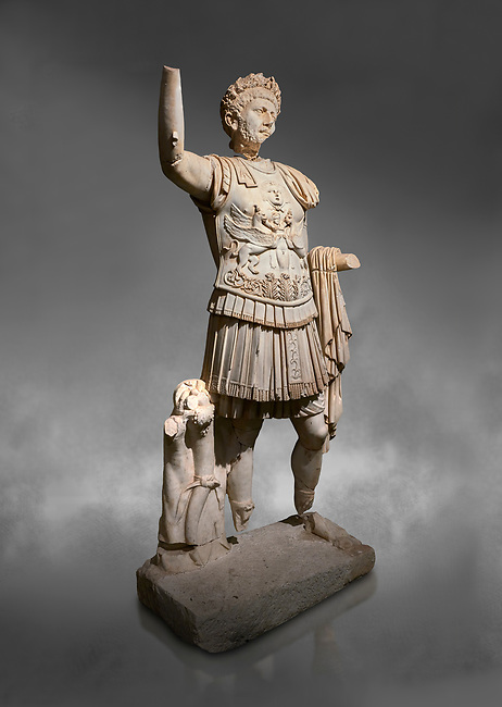 Roman statue of Emperor Trajan. Marble. Perge. 2nd century AD. Inv no . Antalya Archaeology Museum; Turkey.  Against a grey background<br /> <br /> Trajan Roma Emperor  from 98 to 117 AD.
