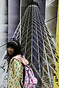 May 15, 2010 - Tokyo, Japan - A visitor walks past near a painting featuring Tokyo Sky Tree at Design Festa at Tokyo Big Sight in Tokyo, Japan, on May 15 2010. The biannually International Art Event that began in 1994 runs from May 15-16, and gives to nearly 8,500 artists working in a variety of mediums an opportunity to showcase their work.