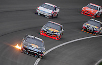 Feb 22, 2009; Fontana, CA, USA; NASCAR Sprint Cup Series driver Matt Kenseth leads a pack of cars during the Auto Club 500 at Auto Club Speedway. Mandatory Credit: Mark J. Rebilas-