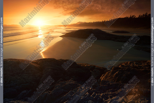 Sunset scenery at Pacific Rim National Park Long Beach. Tofino, Vancouver Island, BC, Canada. Image © MaximImages, License at https://www.maximimages.com