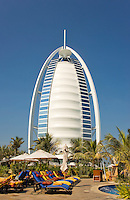 Dubai.  View of Burj al Arab Hotel over executive pool area and gardens of Jumeirah Beach Hotel..