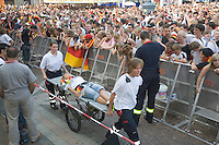 Germany, DEU, Dortmund, 2006-Jun-24: FIFA football world cup (USA: soccer world cup) 2006 in Germany; a victim of the heat is being carried away for medical care at a public viewing zone before the world cup match Germany vs. Sweden (2:0).