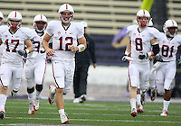 Oct 30, 20010:  Stanford quarterback #12 Andrew Luck leads the offense onto the field against Washington.  Stanford defeated Washington 41-0 at Husky Stadium in Seattle, Washington...