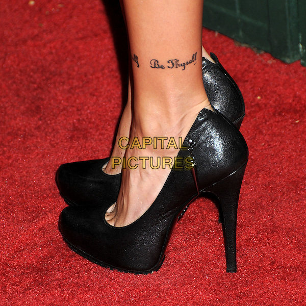 KATIE CASSIDY'S SHOES .7th Annual Teen Vogue Young Hollywood Party held at Milk Studios, Los Angeles, California, USA, .25th September 2009..detail feet tattoo ankle black heels platforms .CAP/ADM/BP.©Byron Purvis/AdMedia/Capital Pictures.