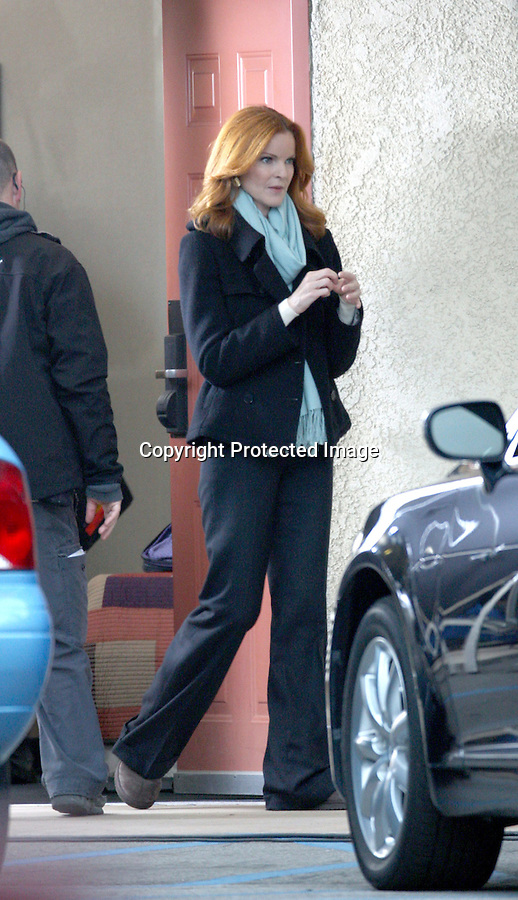 ..December 15th 2010..Marcia Cross filming a scene for Desperate Housewives at a hotel in Burbank California .Marcia was wearing all black with a baby blue scarf getting her makeup and hair put on. ...AbilityFilms@yahoo.com.805-427-3519.www.AbilityFilms.com.