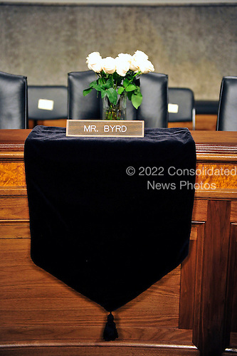 Memorial to the late United States Senator Robert Byrd (Democrat of West Virginia) at his seat at the United States Senate Armed Services Committee prior to the hearing on the nomination of General David H. Petraeus, U.S. Army, to be commander of the International Security Assistance Force and commander of the United States Forces in Afghanistan in Washington, D.C. on Tuesday, June 29, 2010..Credit: Ron Sachs / CNP