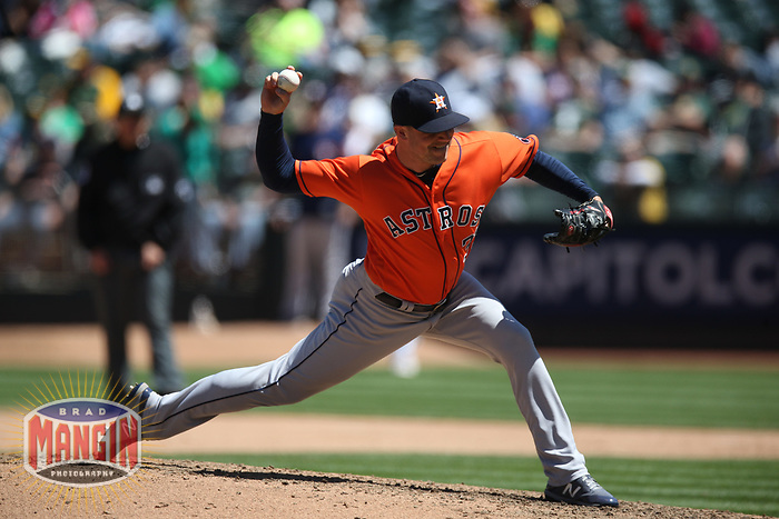 OAKLAND, CA - MAY 9:  Joe Smith #38 of the Houston Astros pitches against the Oakland Athletics during the game at the Oakland Coliseum on Wednesday, May 9, 2018 in Oakland, California. (Photo by Brad Mangin)