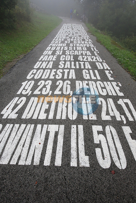 Writing on the road of the vicious 28% Muro di Sormano in preparation for the 2013 Tour of Lombardy, 4th October 2013.<br /> (Photo: Eoin Clarke/www.newsfile.ie)