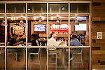 The last customers of the night finish their meals at Grindhouse Killer Burgers in Terminal A at Hartsfield–Jackson Atlanta International Airport, in Atlanta, Georgia on August 28, 2013.