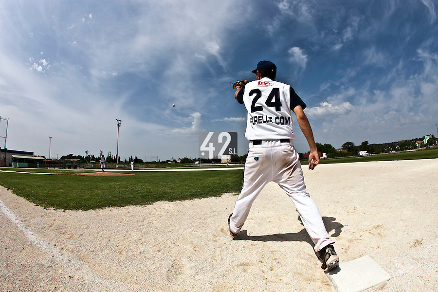 22 May 2009: Thomas Meley of Montpellier eyes the ball during the 2009 challenge de France, a tournament with the best French baseball teams - all eight elite league clubs - to determine a spot in the European Cup next year, at Montpellier, France. Senart wins 7-1 over Montpellier.