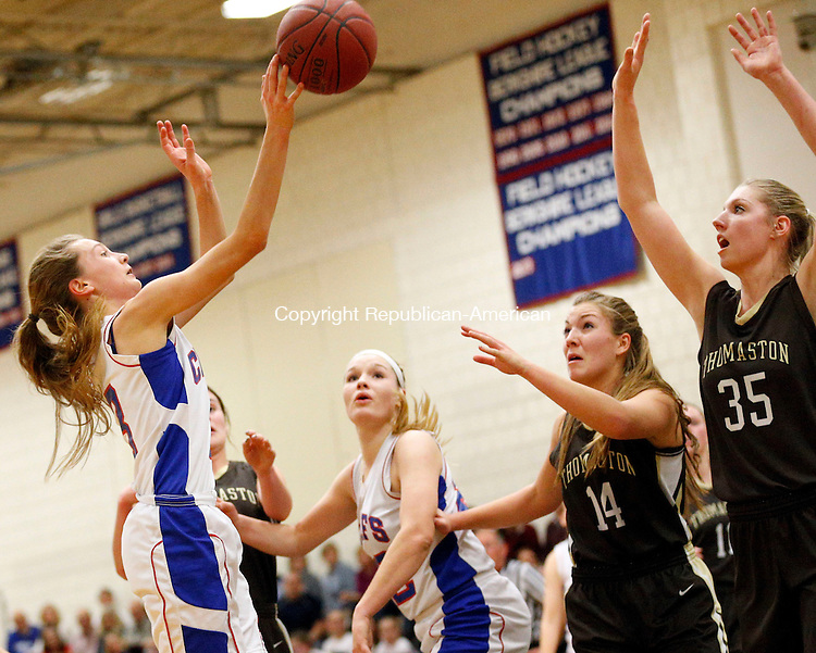 Woodbury, CT- 19 January 2016-011916CM08-  Nonnewaug's Mary Bibbey goes to the basket against Thomaston defenders, Morgan Sanson (14) and Casey Carangelo (35) during their Berkshire League matchup in Woodbury on Tuesday.  Looking on is Nonnewaug's Courtney Carlson. Thomaston would go onto win, 56-36.    Christopher Massa Republican-American