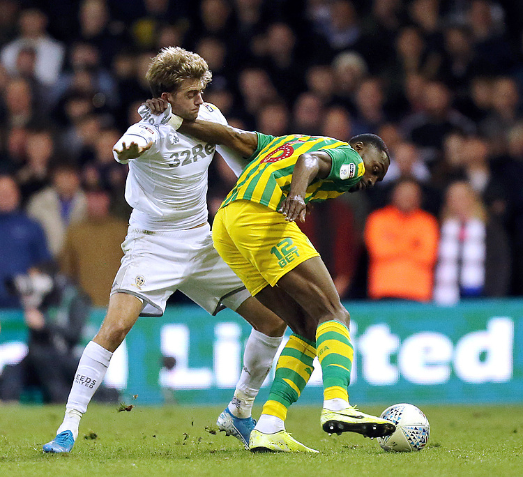 West Bromwich Albion's Kenneth Zohore shields the ball from Leeds United's Patrick Bamford<br /> <br /> Photographer Rich Linley/CameraSport<br /> <br /> The EFL Sky Bet Championship - Tuesday 1st October 2019  - Leeds United v West Bromwich Albion - Elland Road - Leeds<br /> <br /> World Copyright © 2019 CameraSport. All rights reserved. 43 Linden Ave. Countesthorpe. Leicester. England. LE8 5PG - Tel: +44 (0) 116 277 4147 - admin@camerasport.com - www.camerasport.com
