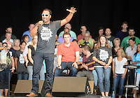 NWA MEDIA SAMANTHA BAKER @NWASAMANTHA<br /> Julio Arriola, global worship pastor for Cross Church, speaks to the congregation Sunday, Aug. 10, 2014, at the Walmart AMP in Rogers during a family worship event. The event invited all five Cross Church campuses.